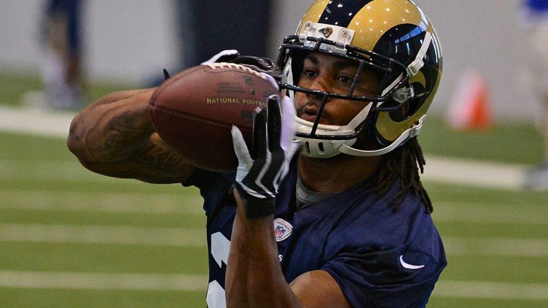 Jul 22, 2014; St. Louis, MO, USA; St. Louis Rams running back Tre Mason (27) runs through drills at Rams Park. Mandatory Credit: Jeff Curry-USA TODAY Sports