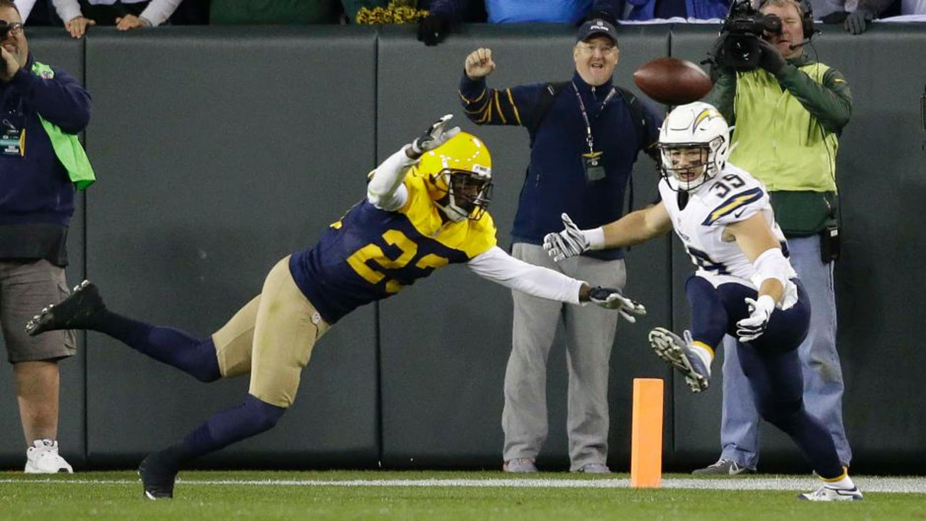 The Green Bay Packers' Damarious Randall (left) deflects a pass intended for the San Diego Chargers' Danny Woodhead on the final play of an NFL game, Sunday, Oct. 18, 2015, in Green Bay, Wis. The Packers won 27-20.