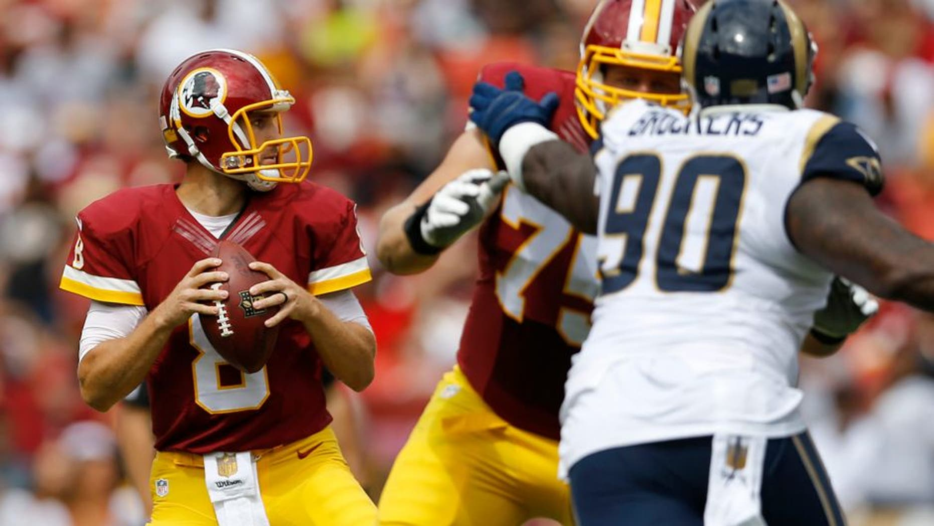 Washington Redskins quarterback Kirk Cousins (8) looks for an opening to pass during the first half of an NFL football game against the St. Louis Rams in Landover, Md., Sunday, Sept. 20, 2015. (AP Photo/Patrick Semansky)