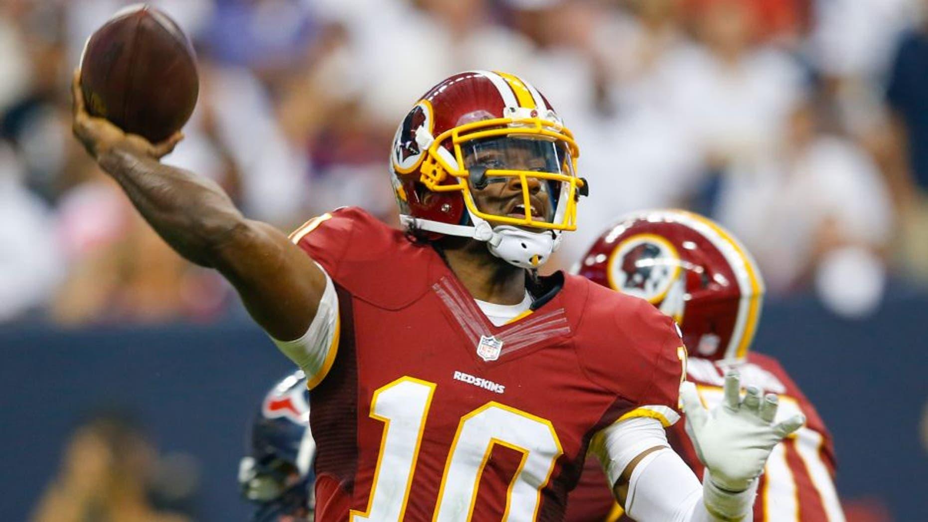 Sep 7, 2014; Houston, TX, USA; Washington Redskins quarterback Robert Griffin III (10) throws during the game against the Houston Texans at NRG Stadium. Mandatory Credit: Kevin Jairaj-USA TODAY Sports