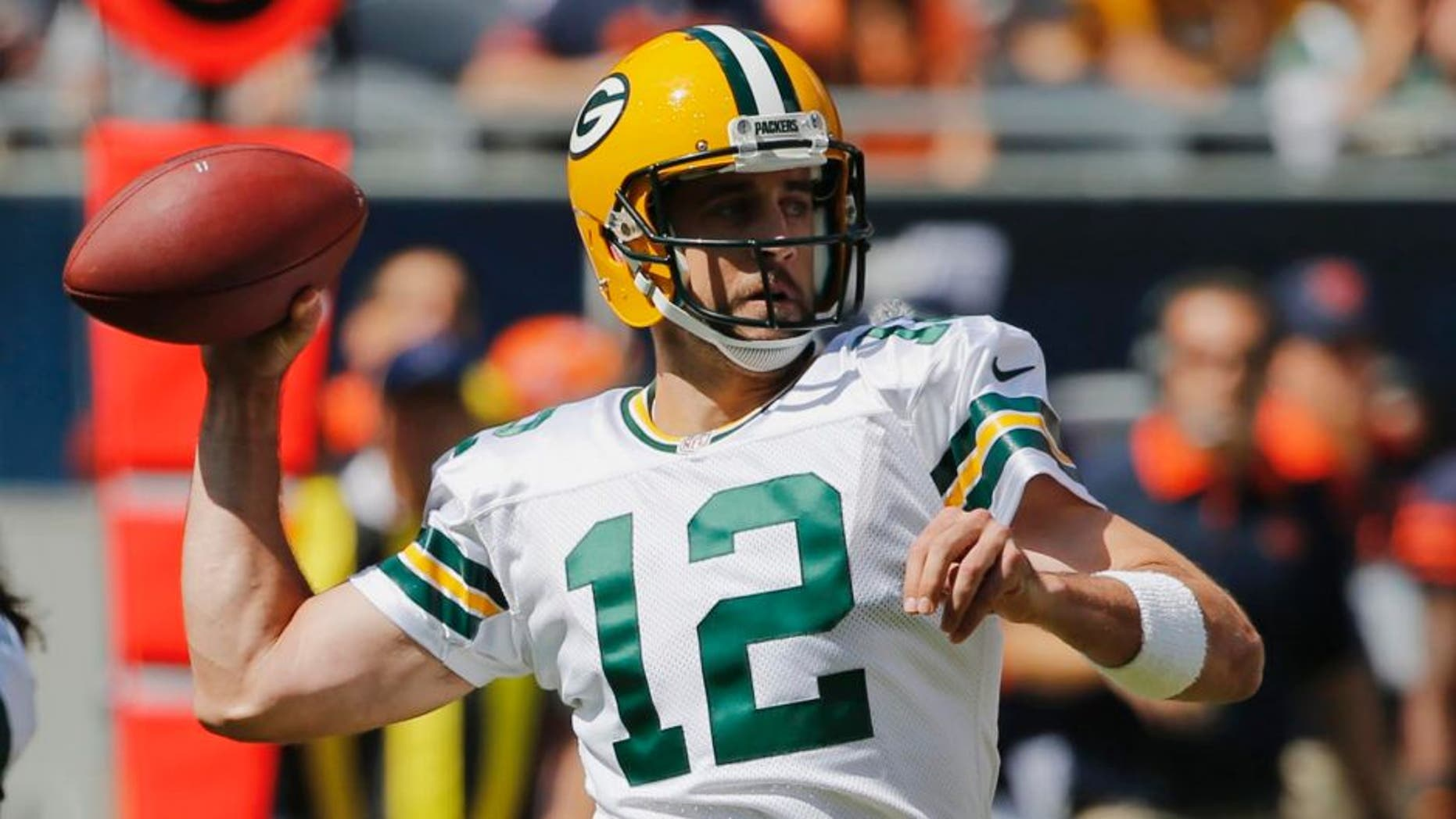 Green Bay Packers quarterback Aaron Rodgers throws a pass during the first half an NFL football game against the Chicago Bears, Sunday, Sept. 13, 2015, in Chicago.