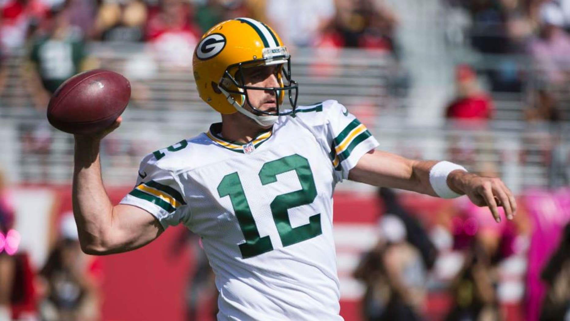 Green Bay Packers quarterback Aaron Rodgers passes the football against the San Francisco 49ers during the first quarter at Levi's Stadium in Santa Clara, Calif., on Sunday, Oct. 4, 2015.