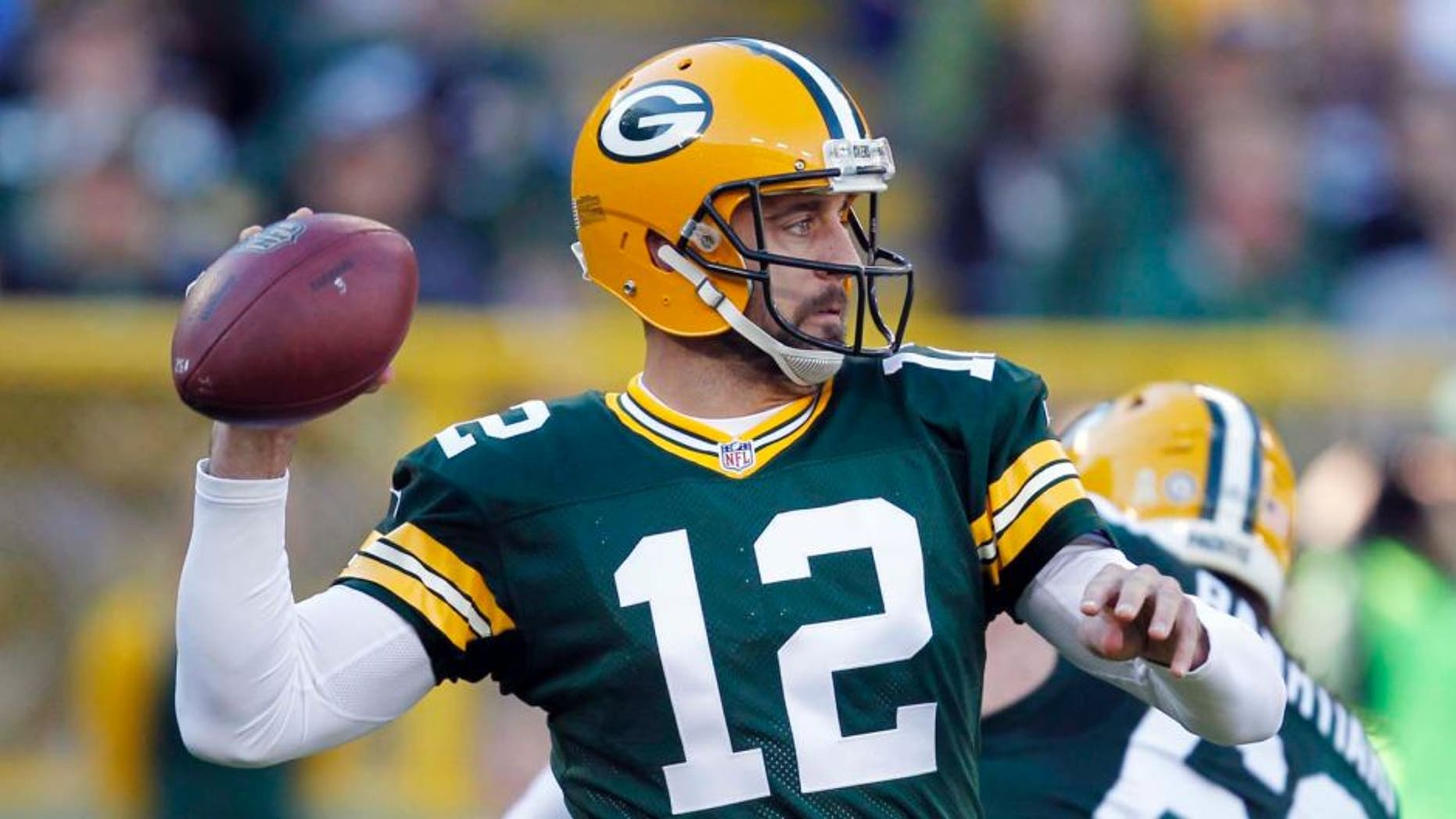 The Green Bay Packers' Aaron Rodgers throws during the first half of an NFL football game against the Detroit Lions on Sunday, Nov. 15, 2015, in Green Bay, Wis.