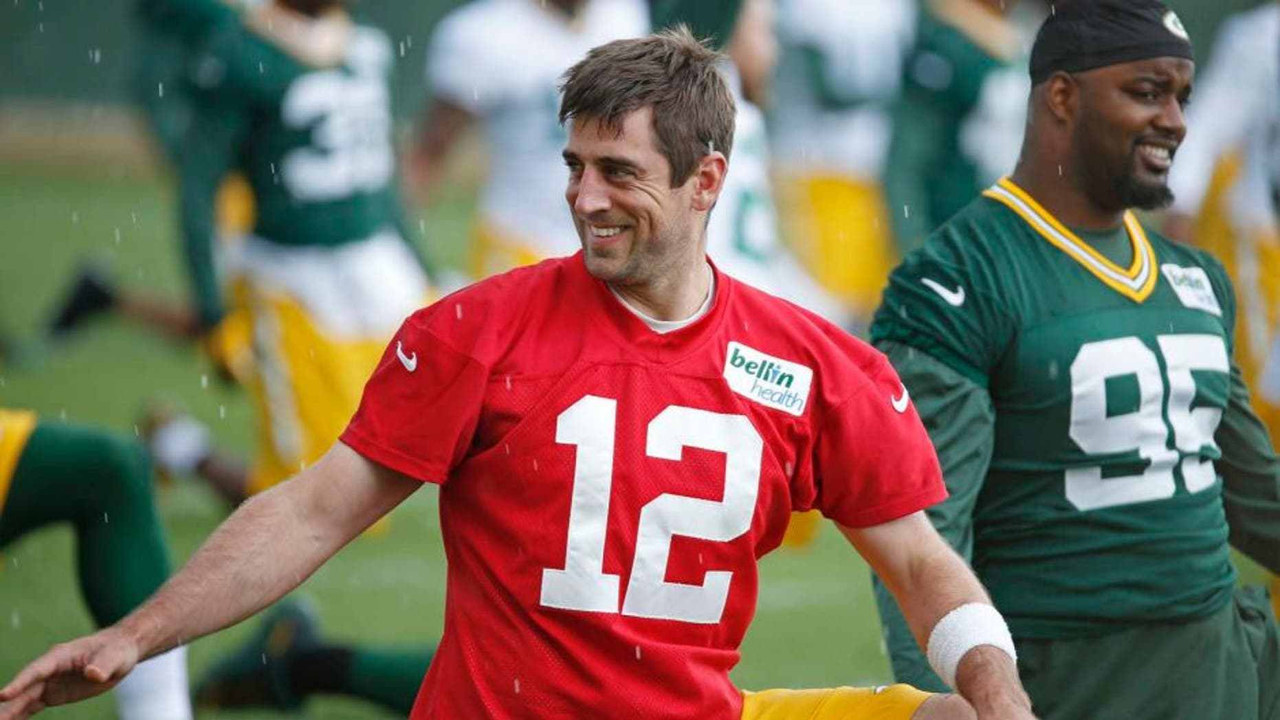 Green Bay Packers quarterback Aaron Rodgers stretches during a practice Monday June 6, 2016, in Green Bay, Wis.