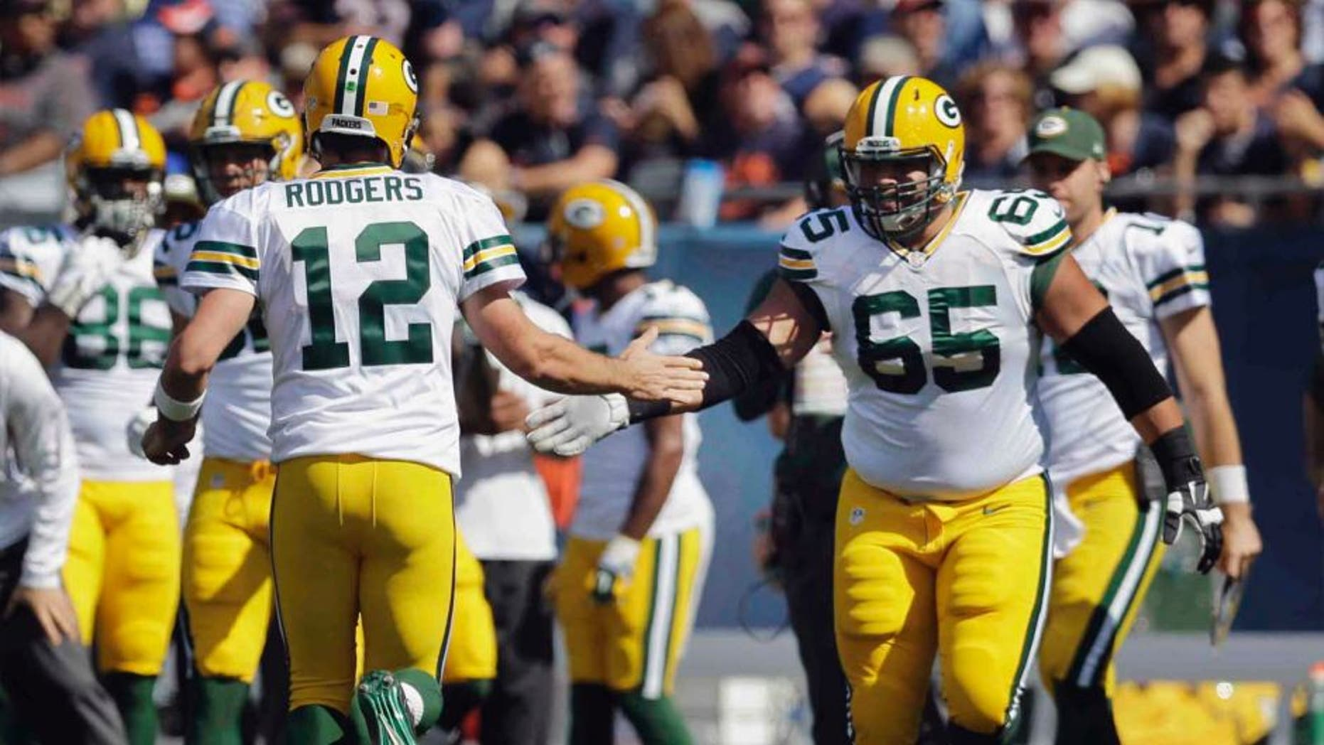 Green Bay Packers quarterback Aaron Rodgers (left) celebrates with guard Lane Taylor after throwing a touchdown pass in the first half.