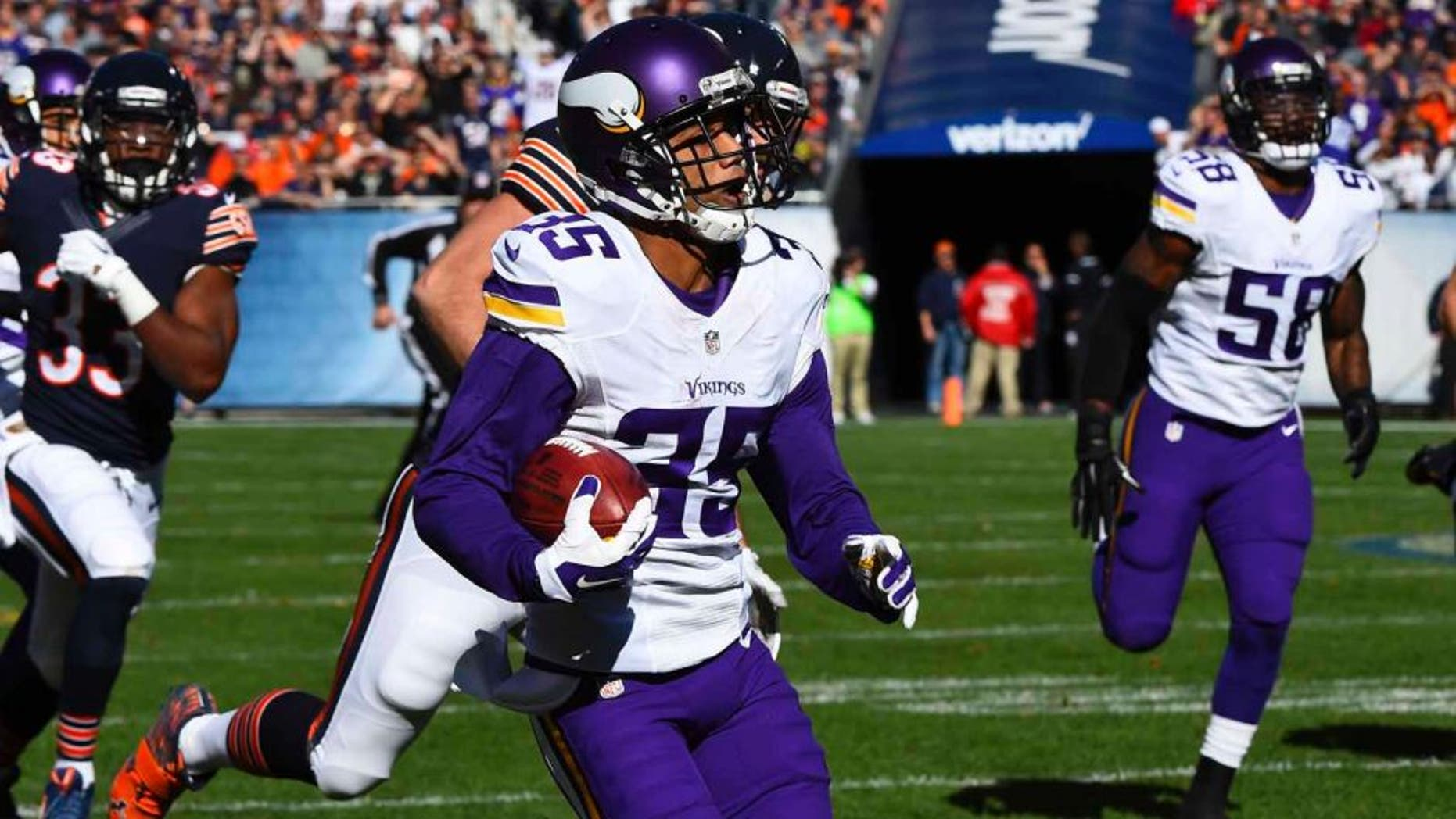 Minnesota Vikings cornerback Marcus Sherels returns a punt for a touchdown against the Chicago Bears during the first half at Soldier Field in Chicago on Sunday, Nov. 1, 2015.