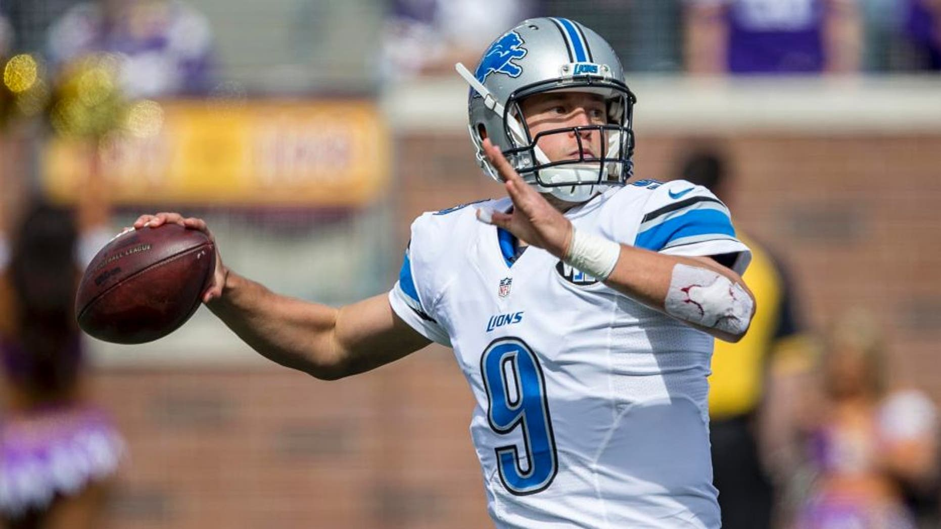 Detroit Lions quarterback Matthew Stafford drops back for a pass in the first half against the Minnesota Vikings at TCF Bank Stadium in Minneapolis on Sunday, Sept. 20, 2015.