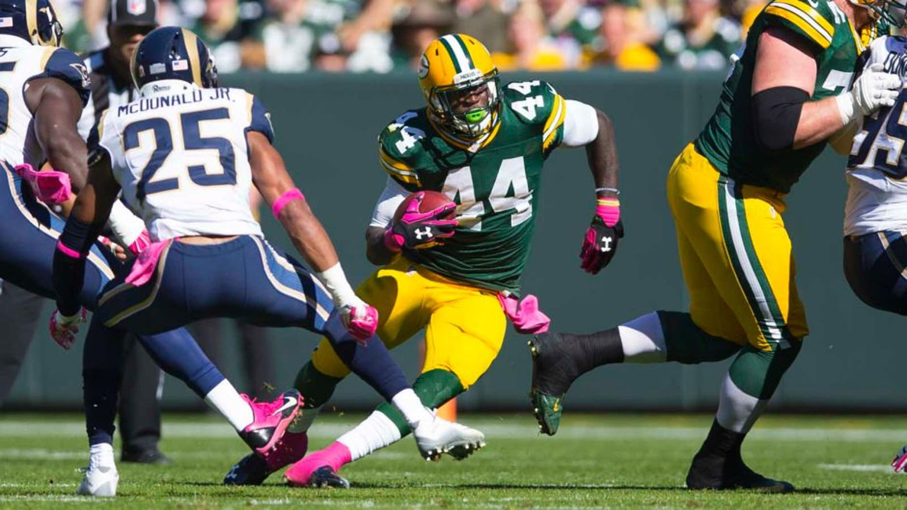 Green Bay Packers running back James Starks rushes with the football during the first quarter against the St. Louis Rams at Lambeau Field in Green Bay, Wis., on Sunday, Oct. 11, 2015.