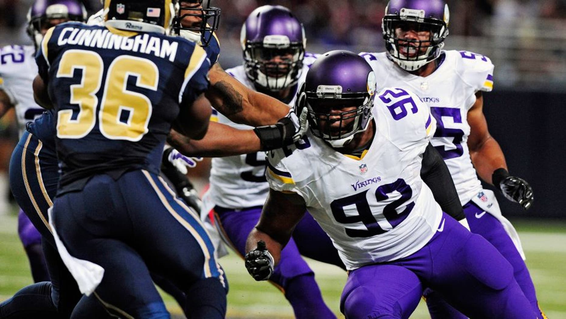 Sep 7, 2014; St. Louis, MO, USA; Minnesota Vikings defensive tackle Tom Johnson (92) defends against St. Louis Rams running back Benny Cunningham (36) during the second half at the Edward Jones Dome. The Vikings defeated the Rams 34-6. Mandatory Credit: Jeff Curry-USA TODAY Sports