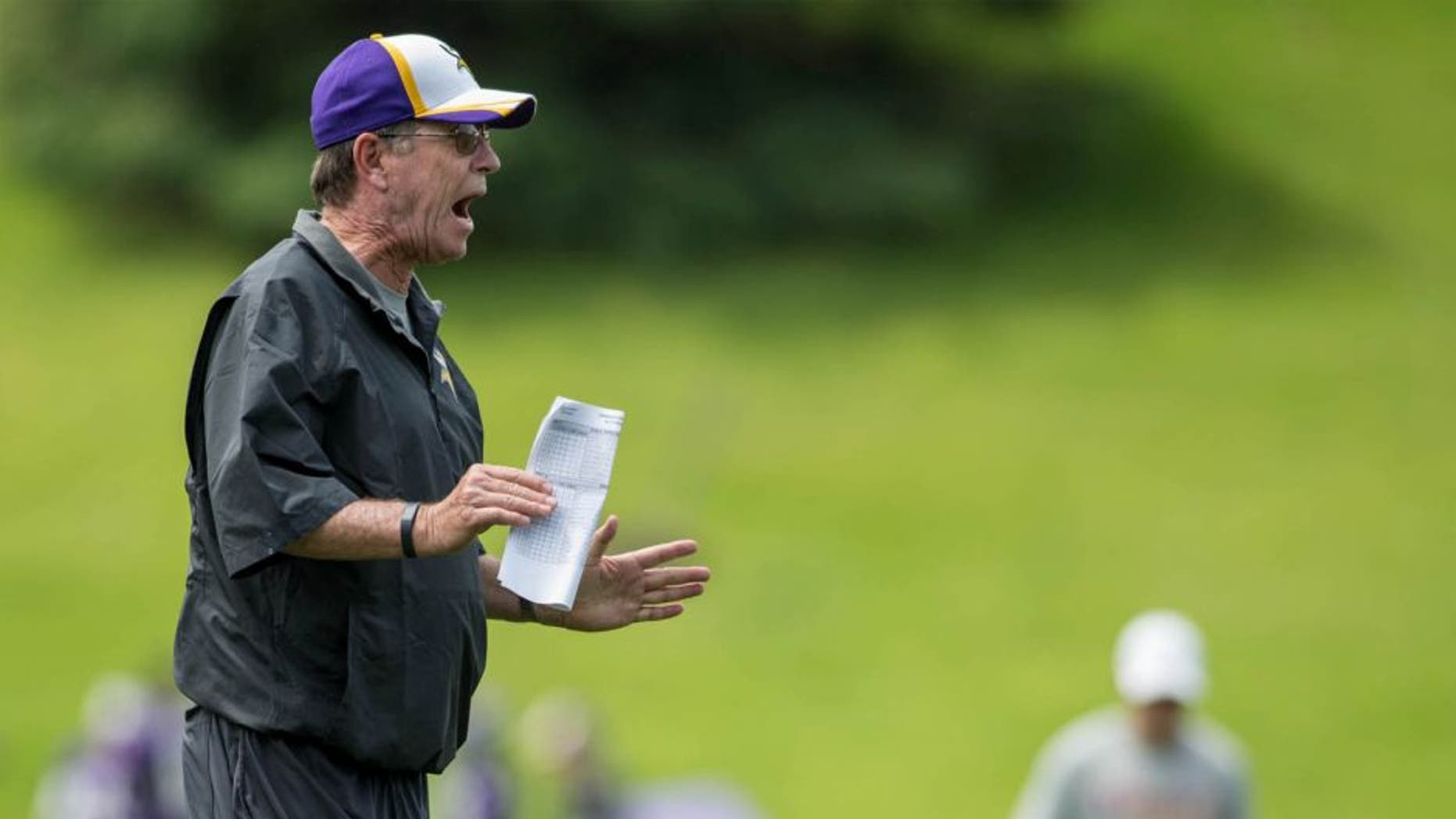 Jun 17, 2014; Eden Prairie, MN, USA; Minnesota Vikings offensive coordinator Norv Turner speaks to his team at practice at Winter Park.
