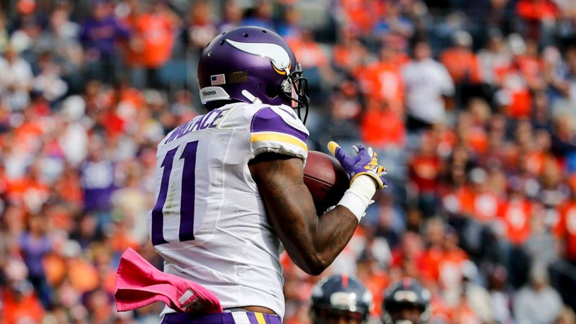 Minnesota Vikings wide receiver Mike Wallace catches a touchdown pass during the first half against the Denver Broncos on Sunday, Oct. 4, 2015, in Denver.