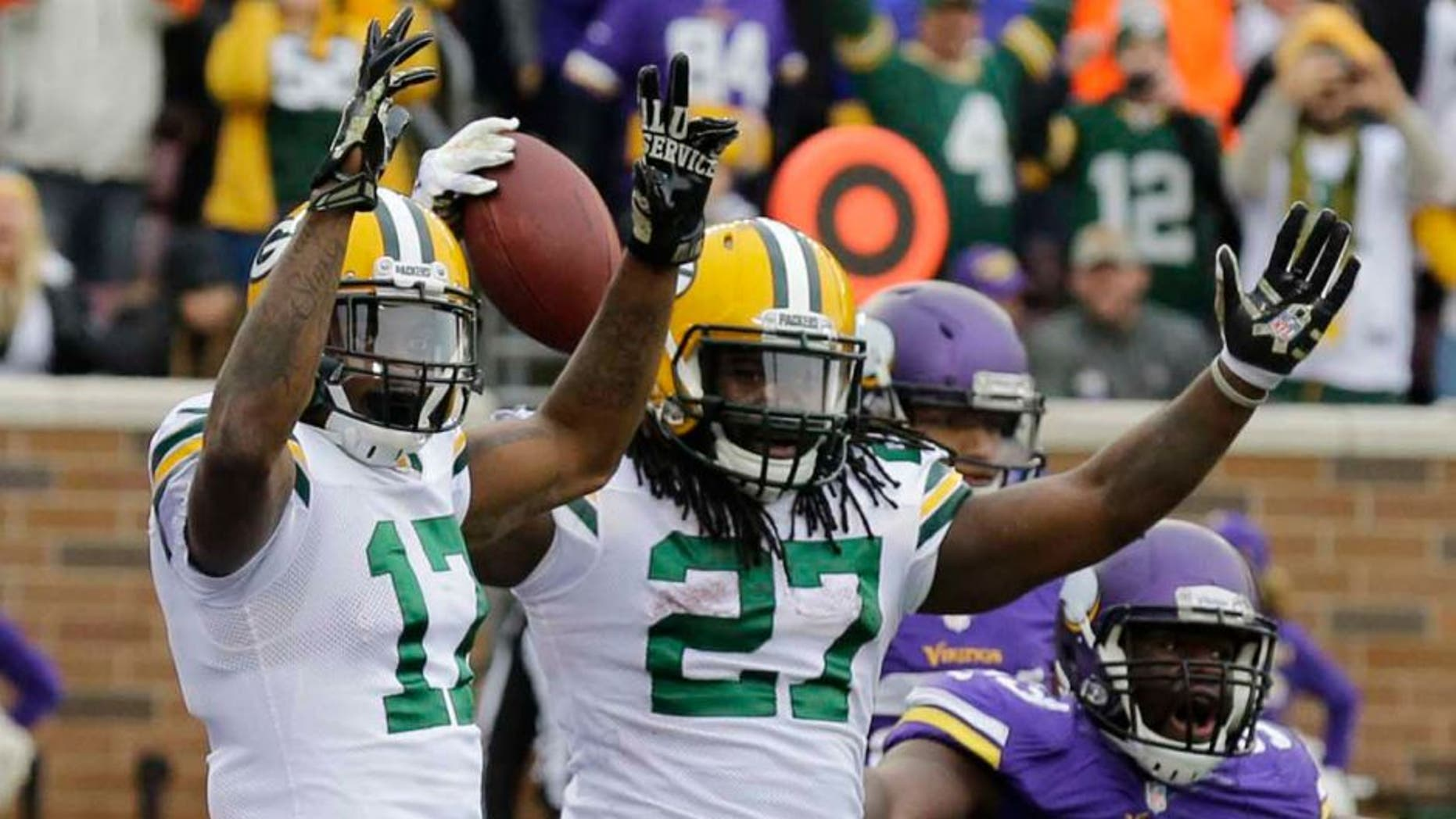 Sunday, November 23: Green Bay Packers running back Eddie Lacy (center) celebrates with teammate Davante Adams (left) after scoring on a 10-yard touchdown reception during the second half. Minnesota Vikings defensive tackle Shamar Stephen (right) disputes the call.