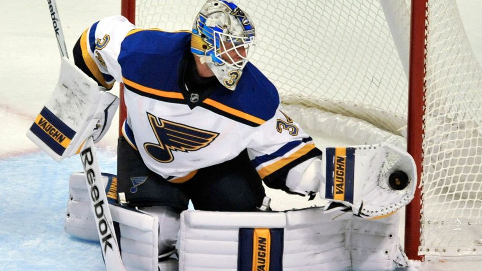 St. Louis Blues goalie Jake Allen (34) makes a save during the second period of a preseason NHL hockey game against the Chicago Blackhawks on Saturday, Sept. 26, 2015, in Chicago. (AP Photo/Paul Beaty)