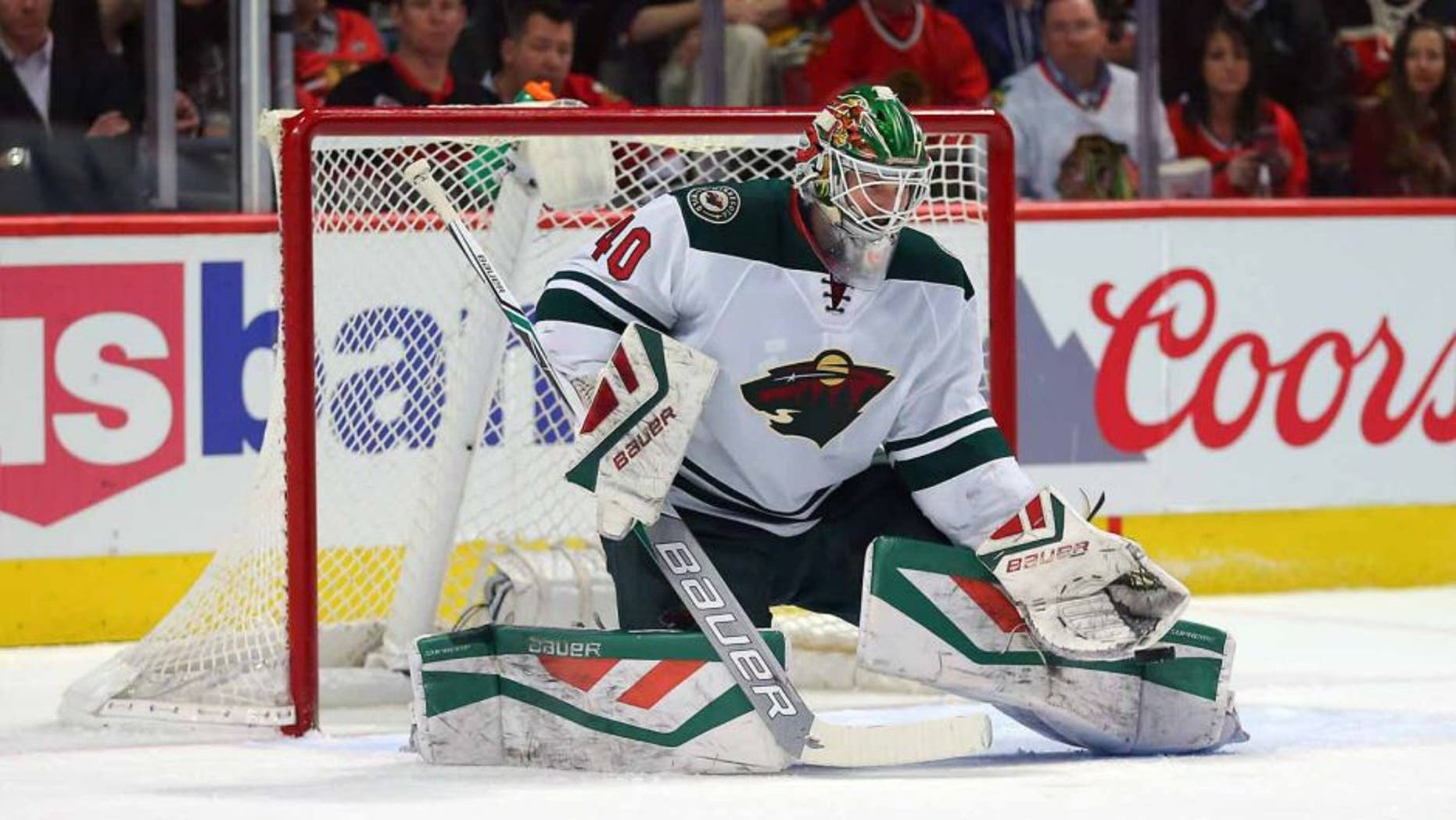 Minnesota Wild goalie Devan Dubnyk makes a save against the Chicago Blackhawks at the United Center in Chicago on March 20, 2016.