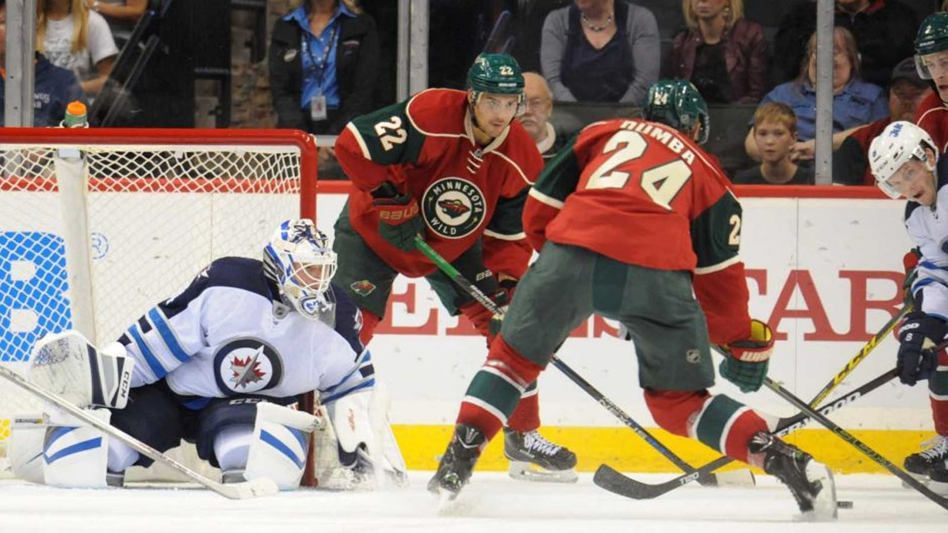 Minnesota Wild defenseman Matt Dumba shoots and scores on Winnipeg Jets goalie Michael Hutchinson during the first period of a preseason game at Xcel Energy Center in St. Paul, Minn., on Sunday, Sept. 27, 2015.