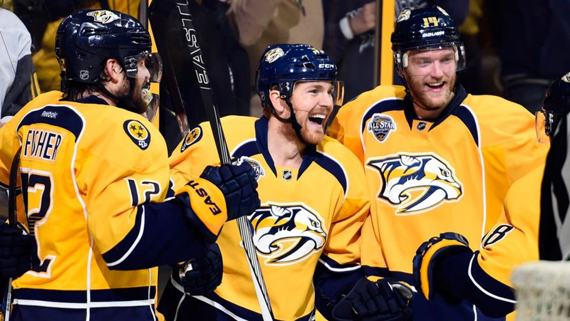 May 3, 2016; Nashville, TN, USA; Nashville Predators players celebrate after a goal left winger Colin Wilson (33) during the third period against the San Jose Sharks in game three of the second round of the 2016 Stanley Cup Playoffs at Bridgestone Arena. Mandatory Credit: Christopher Hanewinckel-USA TODAY Sports
