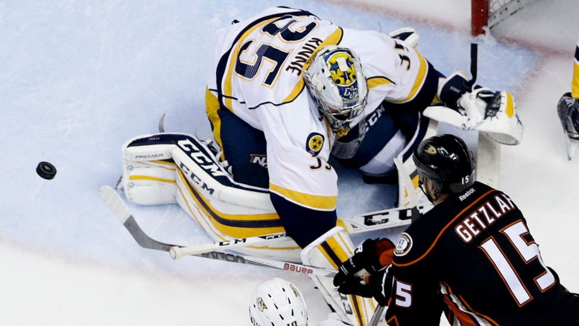 Nashville Predators goalie Pekka Rinne, left, blocks a shot by Anaheim Ducks center Ryan Getzlaf during the second period of Game 2 of an NHL hockey first-round Stanley Cup playoff series in Anaheim, Calif., Sunday, April 17, 2016. (AP Photo/Chris Carlson)