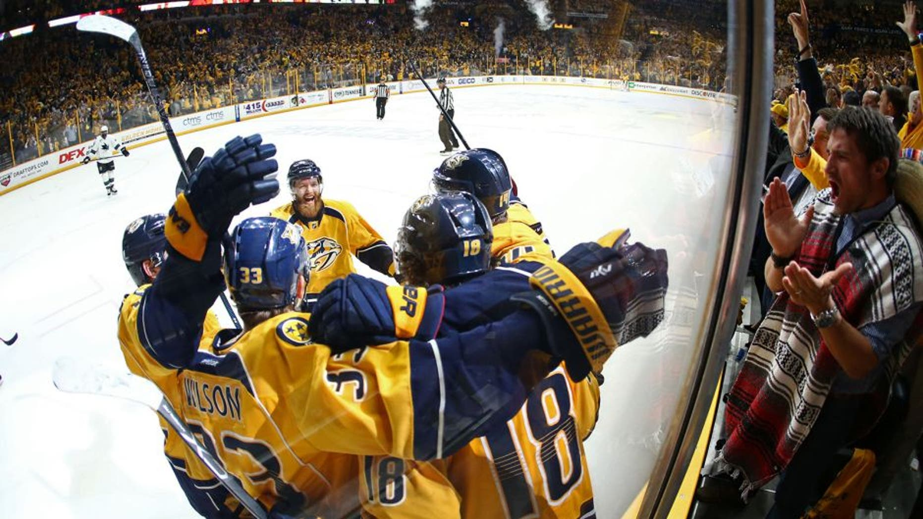May 5, 2016; Nashville, TN, USA; Nashville Predators left wing James Neal (18) celebrates with teammates along the boards after scoring a goal against the San Jose Sharks during the third period in game four of the second round of the 2016 Stanley Cup Playoffs at Bridgestone Arena. Mandatory Credit: Aaron Doster-USA TODAY Sports