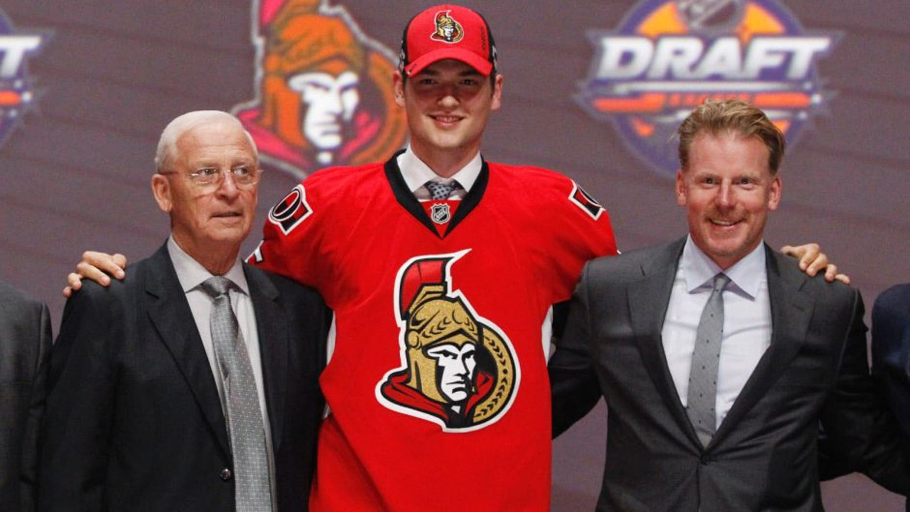 Jun 24, 2016; Buffalo, NY, USA; Logan Brown poses for a photo after being selected as the number eleven overall draft pick by the Ottawa Senators in the first round of the 2016 NHL Draft at the First Niagra Center. Mandatory Credit: Timothy T. Ludwig-USA TODAY Sports