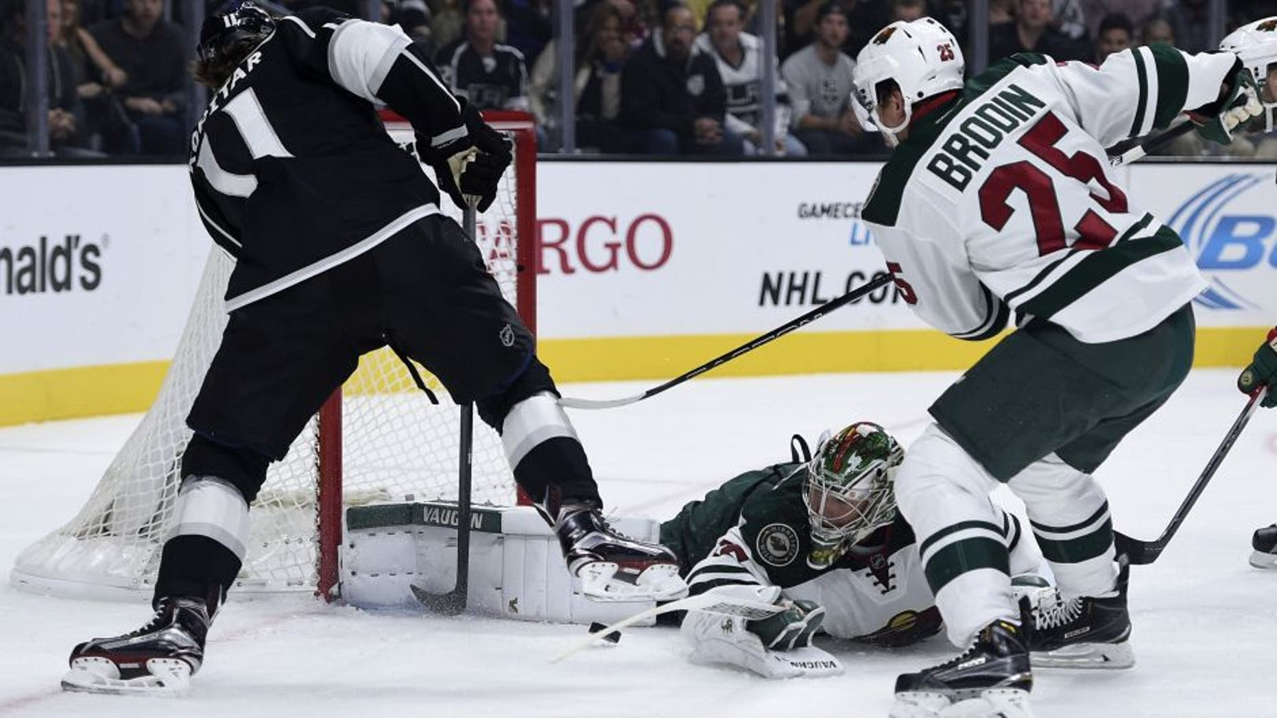 Oct 16, 2015; Los Angeles, CA, USA; Minnesota Wild goalie Darcy Kemper (center) blocks a shot by Los Angeles Kings center Anze Kopitar (left) during the first period at Staples Center. Mandatory Credit: Kelvin Kuo-USA TODAY Sports