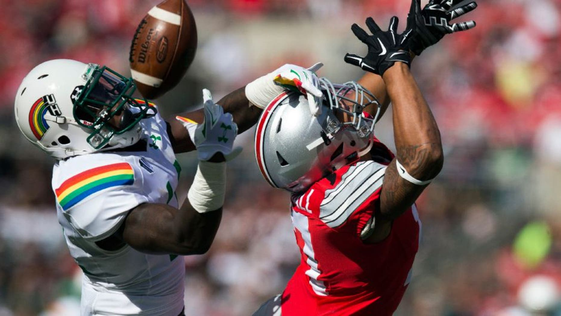 Hawaii Warriors defensive back Nick Nelson deflects a pass away from Ohio State Buckeyes running back Jalin Marshall.