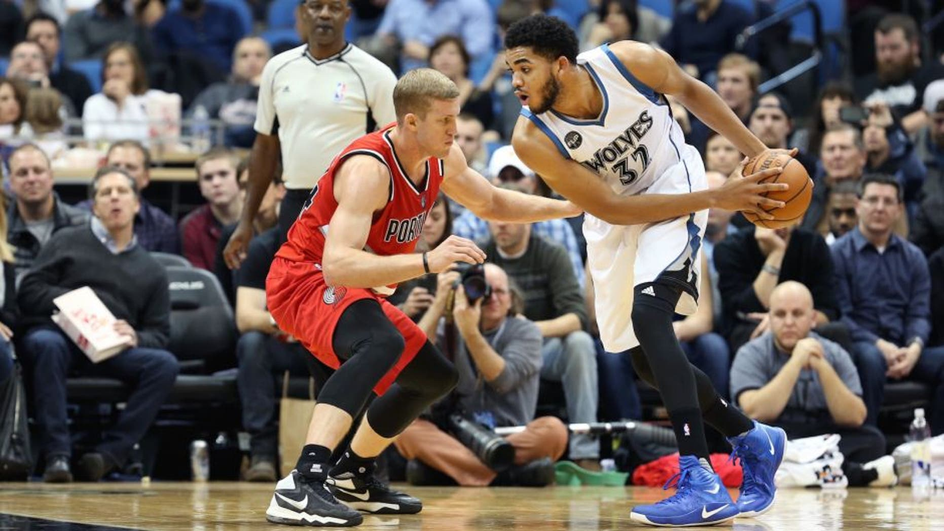 MINNEAPOLIS, MN - DECEMBER 5: Karl-Anthony Towns #32 of the Minnesota Timberwolves defends the ball against the Portland Trail Blazers during the game on December 5, 2015 at Target Center in Minneapolis, Minnesota. NOTE TO USER: User expressly acknowledges and agrees that, by downloading and or using this Photograph, user is consenting to the terms and conditions of the Getty Images License Agreement. Mandatory Copyright Notice: Copyright 2015 NBAE (Photo by Jordan Johnson/NBAE via Getty Images)