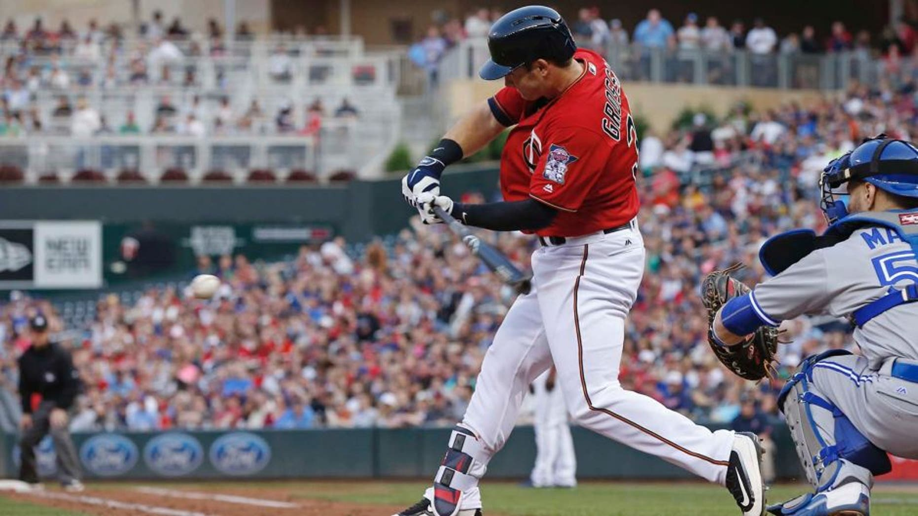Minnesota Twins' Robbie Grossman hits an RBI double off Toronto Blue Jays pitcher Aaron Sanchez in the second inning of a baseball game Friday, May 20, 2016, in Minneapolis. (AP Photo/Jim Mone)