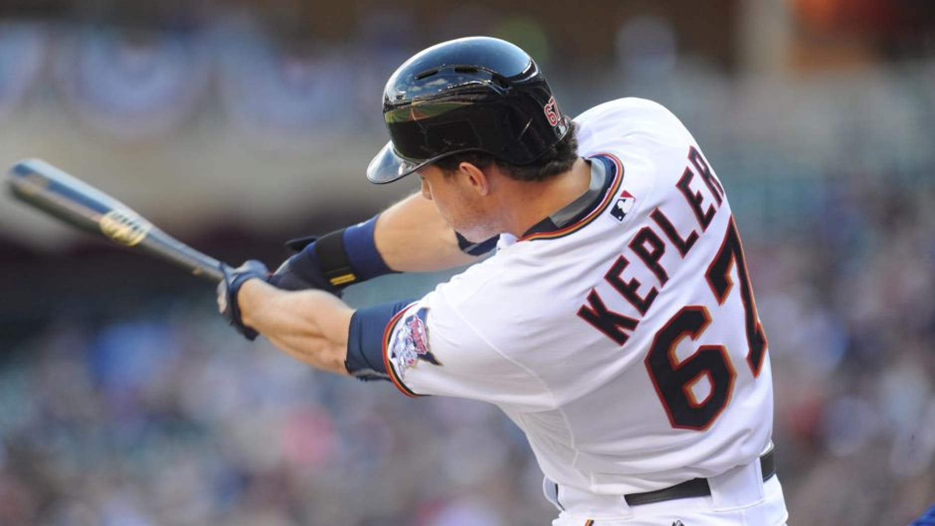 Oct 4, 2015; Minneapolis, MN, USA; Minnesota Twins right fielder Max Kepler (67) gets a base hit during the first inning against the Kansas City Royals at Target Field.
