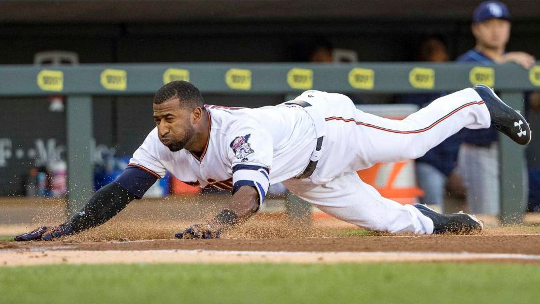 Jun 2, 2016; Minneapolis, MN, USA; Minnesota Twins shortstop Eduardo Nunez (9) slides into home plate safely for an inside the park home run in the first inning against the Tampa Bay Rays at Target Field. Mandatory Credit: Jesse Johnson-USA TODAY Sports