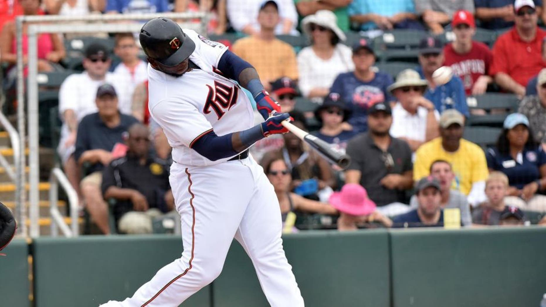 Mar 29, 2016; Fort Myers, FL, USA; Minnesota Twins right fielder Miguel Sano (22) connects for a solo home run during a spring training game against the Boston Red Sox at CenturyLink Sports Complex. Mandatory Credit: Steve Mitchell-USA TODAY Sports
