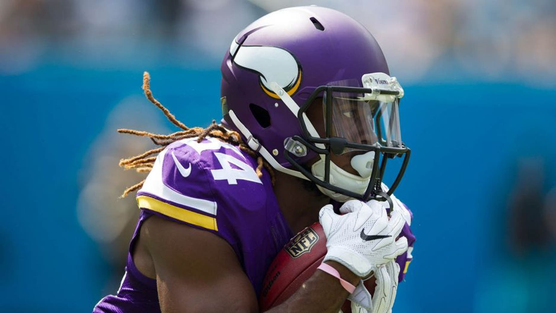 Sep 25, 2016; Charlotte, NC, USA; Minnesota Vikings wide receiver Cordarrelle Patterson (84) runs the ball during the first quarter against the Carolina Panthers at Bank of America Stadium. Mandatory Credit: Jeremy Brevard-USA TODAY Sports