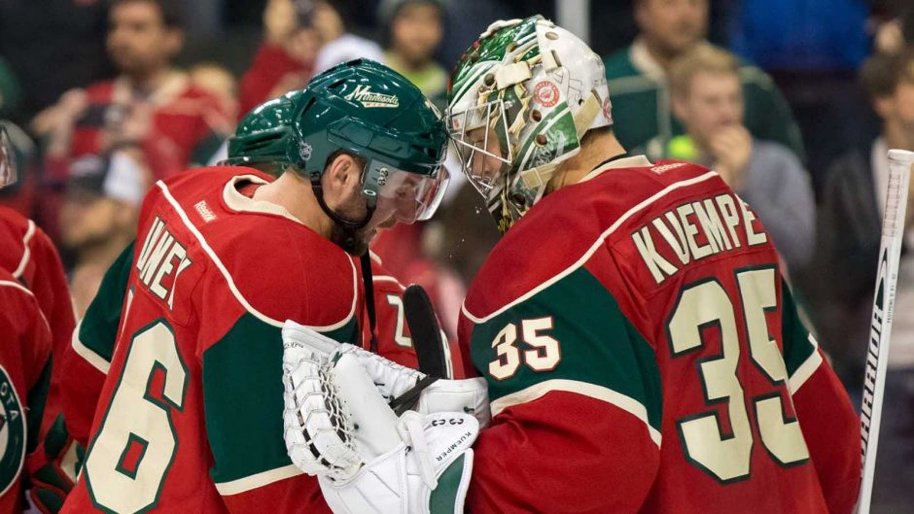 Dec 15, 2015; Saint Paul, MN, USA; Minnesota Wild forward Thomas Vanek (26) and goalie Darcy Kuemper (35) celebrate the win after the game against the Vancouver Canucks at Xcel Energy Center. The Minnesota Wild beat the Vancouver Canucks 6-2. Mandatory Credit: Brad Rempel-USA TODAY Sports