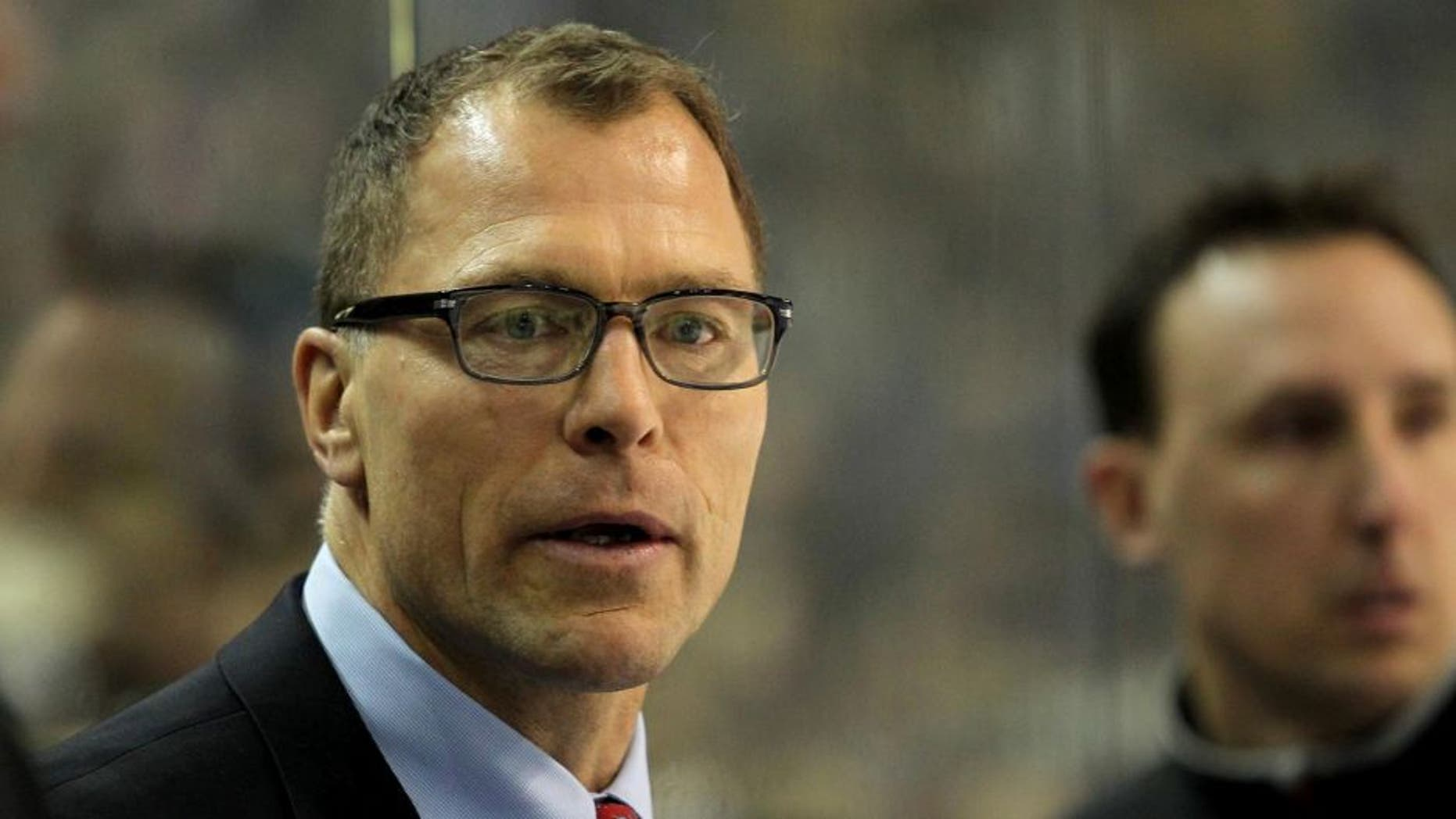Mar. 2, 2013; Buffalo, NY, USA; New Jersey Devils assistant coach Scott Stevens on the bench against the Buffalo Sabres at First Niagara Center. Mandatory Credit: Timothy T. Ludwig-USA TODAY Sports