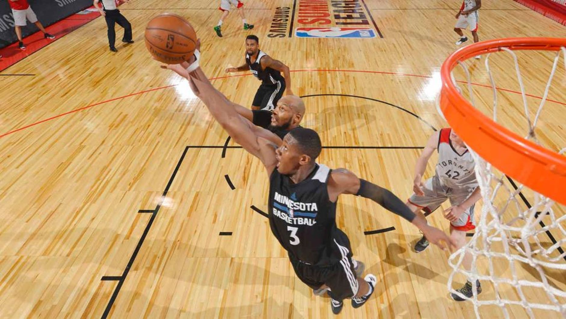 LAS VEGAS, NV - JULY 10: Kris Dunn #3 of the Minnesota Timberwolves jumps for the rebound against the Toronto Raptors during the 2016 Las Vegas Summer League on July 10, 2016 at Cox Pavillon in Las Vegas, Nevada. NOTE TO USER: User expressly acknowledges and agrees that, by downloading and or using this Photograph, user is consenting to the terms and conditions of the Getty Images License Agreement. Mandatory Copyright Notice: Copyright 2016 NBAE (Photo by David Dow/NBAE via Getty Images)