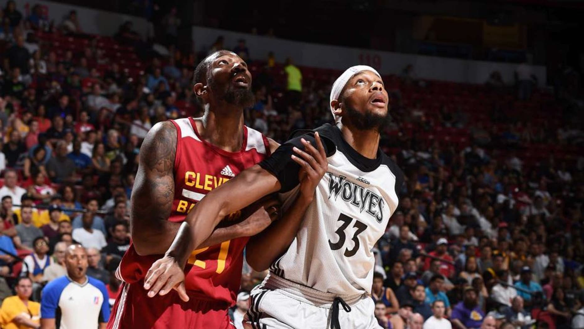 LAS VEGAS, NV - JULY 11: Cory Jefferson #21 of the Cleveland Cavaliers fights for position against Adreian Payne #33 of the Minnesota Timberwolves during the 2016 NBA Las Vegas Summer League on July 11, 2016 at The Thomas & Mack Center in Las Vegas, Nevada. NOTE TO USER: User expressly acknowledges and agrees that, by downloading and or using this photograph, user is consenting to the terms and conditions of Getty Images License Agreement. Mandatory Copyright Notice: Copyright 2016 NBAE (Photo by Garrett Ellwood/NBAE via Getty Images)
