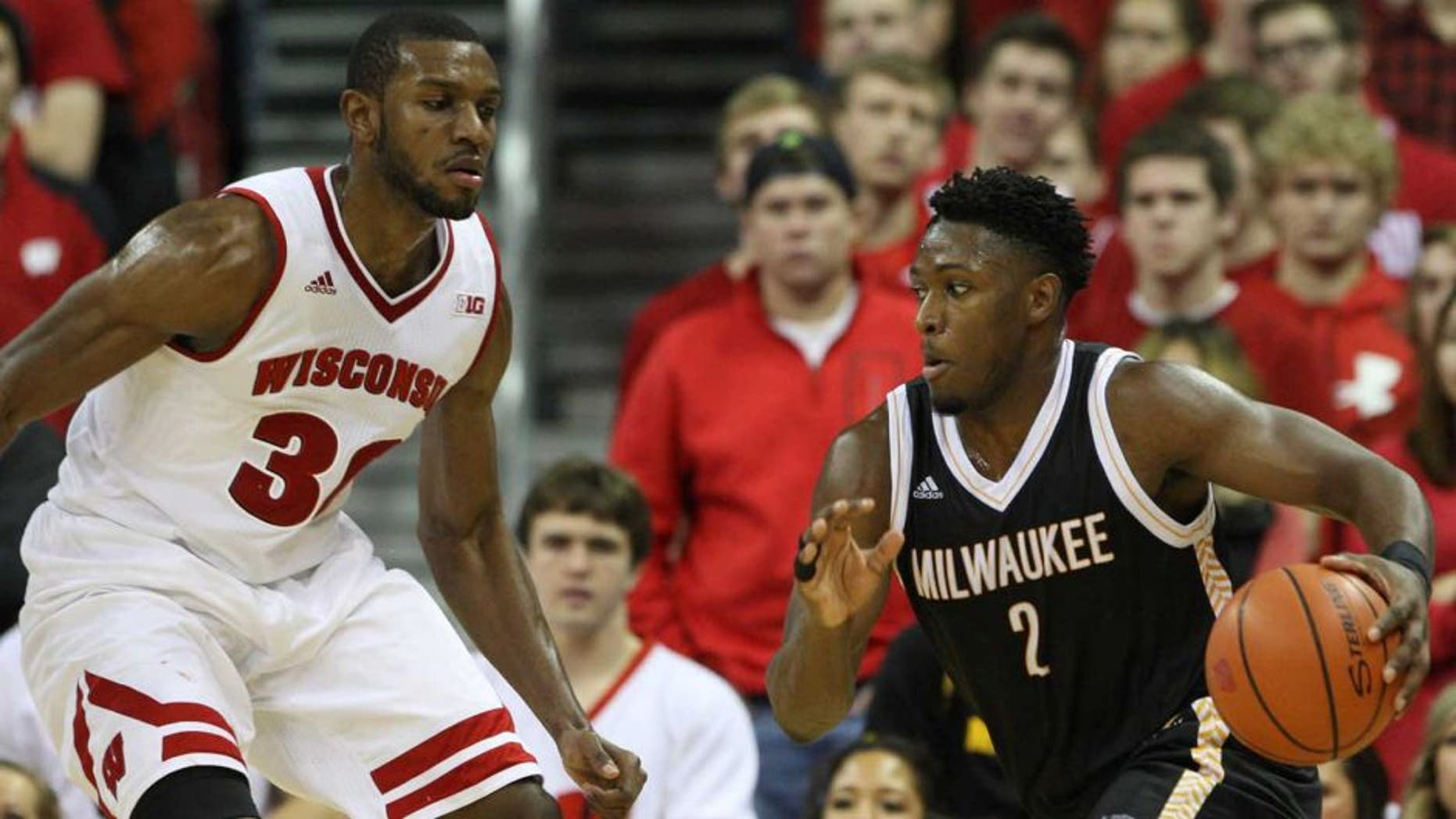 Dec 9, 2015; Madison, WI, USA; Wisconsin-Milwaukee Panthers guard Akeem Springs (2) drive the ball against Wisconsin Badgers forward Vitto Brown (30) at the Kohl Center. Wisconsin-Milwaukee defeated Wisconsin 68-67. Mandatory Credit: Mary Langenfeld-USA TODAY Sports