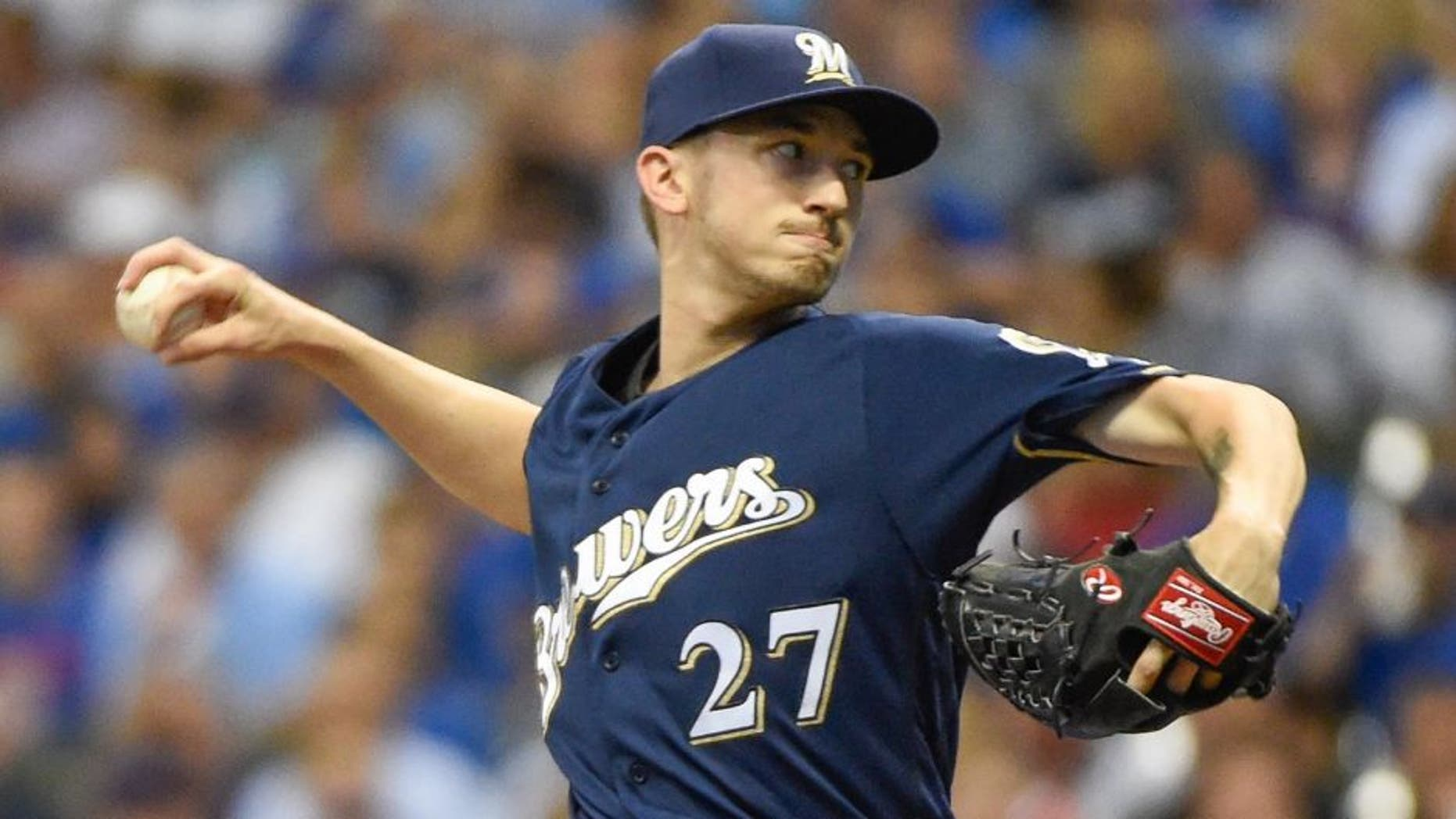 Milwaukee Brewers starting pitcher Zach Davies throws during the first inning of a baseball game against the Chicago Cubs, Saturday, July 23, 2016, in Milwaukee. (AP Photo/Benny Sieu)