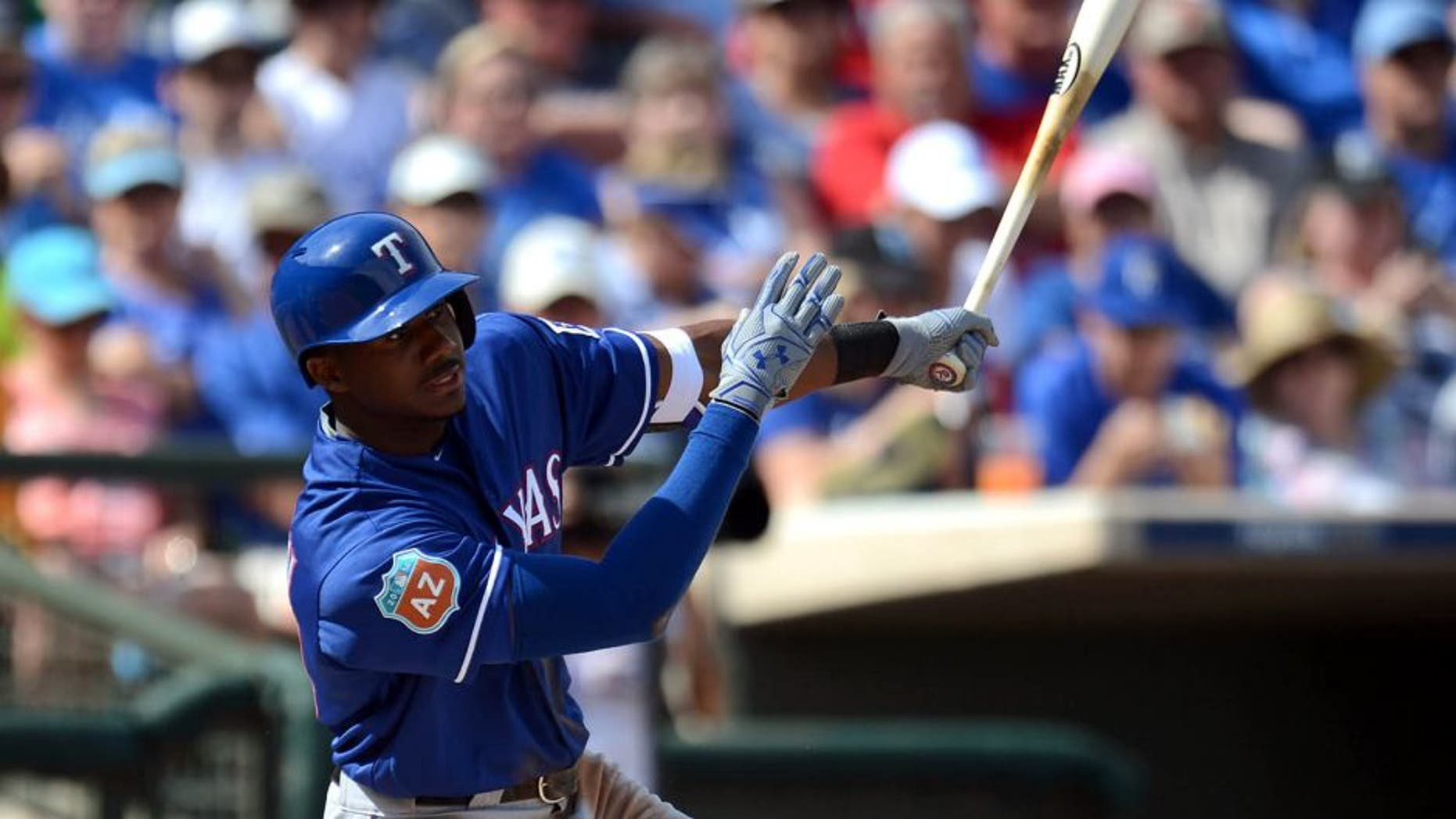 Mar 3, 2016; Surprise, AZ, USA; Texas Rangers center fielder Lewis Brinson (70) swings at a pitch during the second inning against the Kansas City Royals at Surprise Stadium. Mandatory Credit: Joe Camporeale-USA TODAY Sports