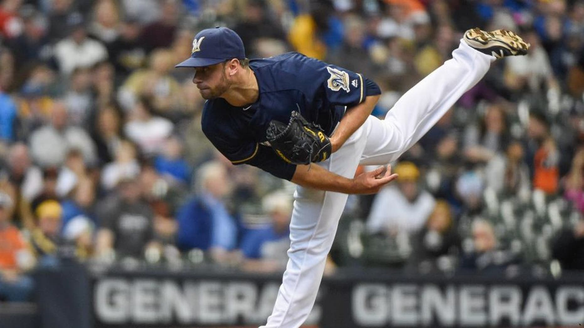Apr 6, 2016; Milwaukee, WI, USA; Milwaukee Brewers pitcher Tyler Thornburg (37) pitched an inning of scoreless relief against the San Francisco Giants at Miller Park. Thornburg picked up the win as the Brewers beat the Giants 4-3. Mandatory Credit: Benny Sieu-USA TODAY Sports