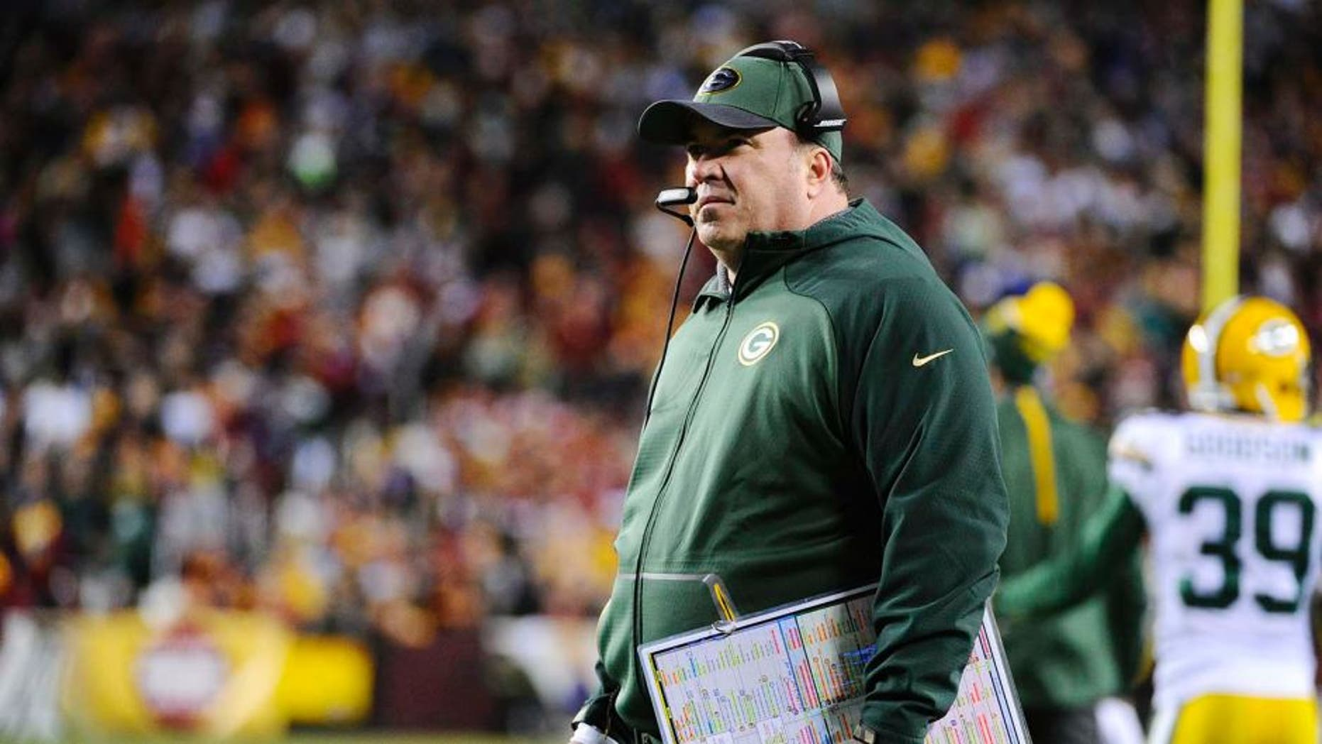 Jan 10, 2016; Landover, MD, USA; Green Bay Packers head coach Mike McCarthy looks on from the sidelines against the Washington Redskins during the second half in a NFC Wild Card playoff football game at FedEx Field. Mandatory Credit: Brad Mills-USA TODAY Sports