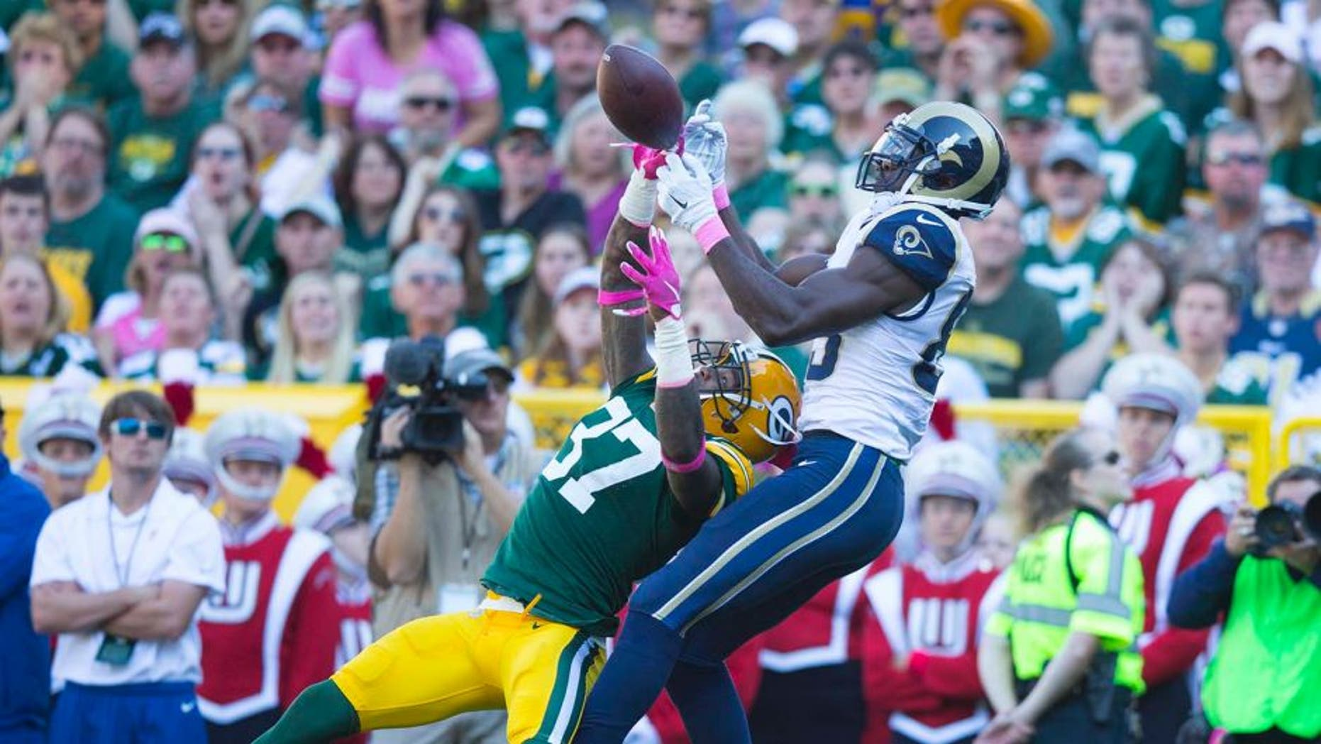 Oct 11, 2015; Green Bay, WI, USA; Green Bay Packers cornerback Sam Shields (37) breaks up the pass intended for St. Louis Rams wide receiver Brian Quick (83) during the second quarter at Lambeau Field. Mandatory Credit: Jeff Hanisch-USA TODAY Sports