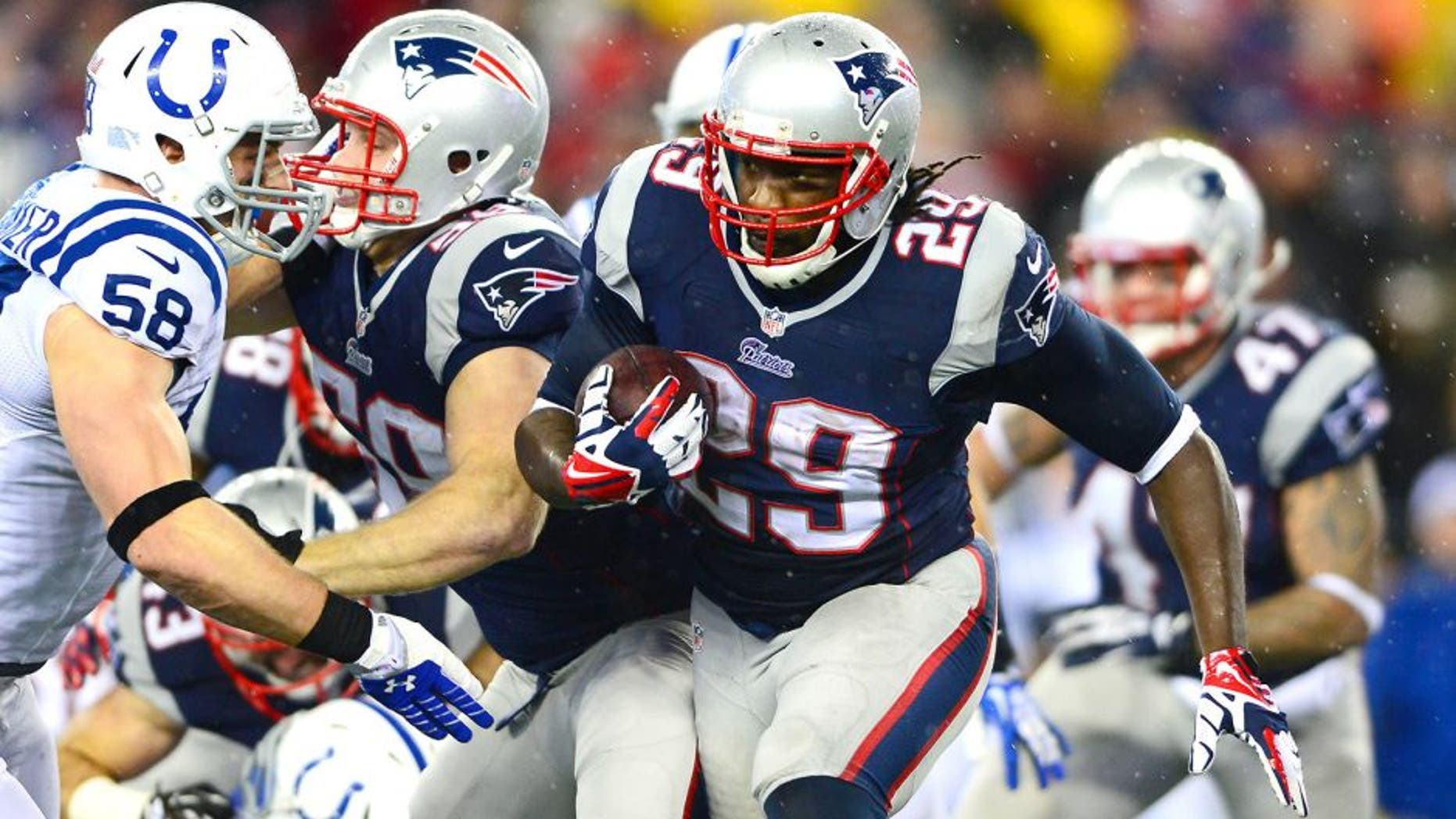 Jan 11, 2014; Foxborough, MA, USA; New England Patriots running back LeGarrette Blount (29) runs the ball during the second quarter of the 2013 AFC divisional playoff football game against the Indianapolis Colts at Gillette Stadium. Mandatory Credit: Andrew Weber-USA TODAY Sports