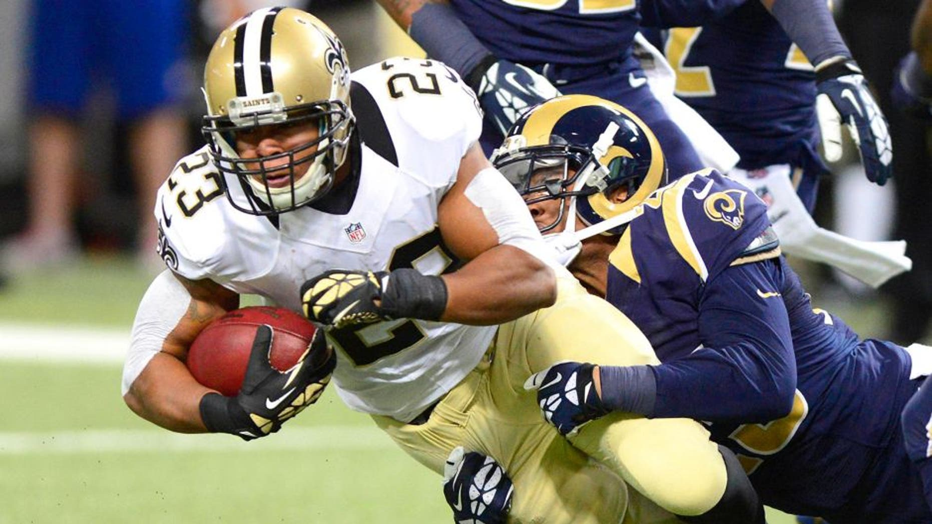Dec 15, 2013; St. Louis, MO, USA; New Orleans Saints running back Pierre Thomas (23) is tackled by St. Louis Rams free safety Rodney McLeod (23) during the first half at the Edward Jones Dome. The Rams defeated the Saints 27-16. Mandatory Credit: Jeff Curry-USA TODAY Sports