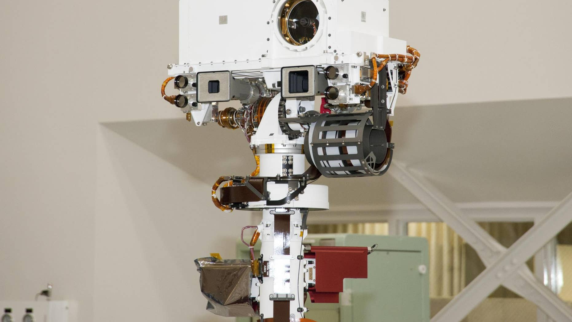 The remote sensing mast on NASA Mars rover Curiosity holds two science instruments for studying the rover surroundings and two stereo navigation cameras for use in driving the rover and planning rover activities.