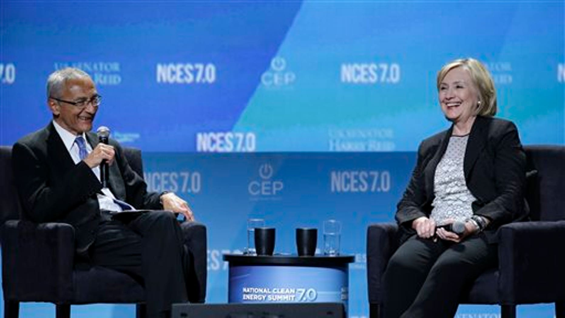 Former Secretary of State Hillary Rodham Clinton, right, takes questions from John Podesta, counselor to President Barack Obama, at the National Clean Energy Summit Thursday, Sept. 4, 2014, in Las Vegas. (AP Photo/John Locher)