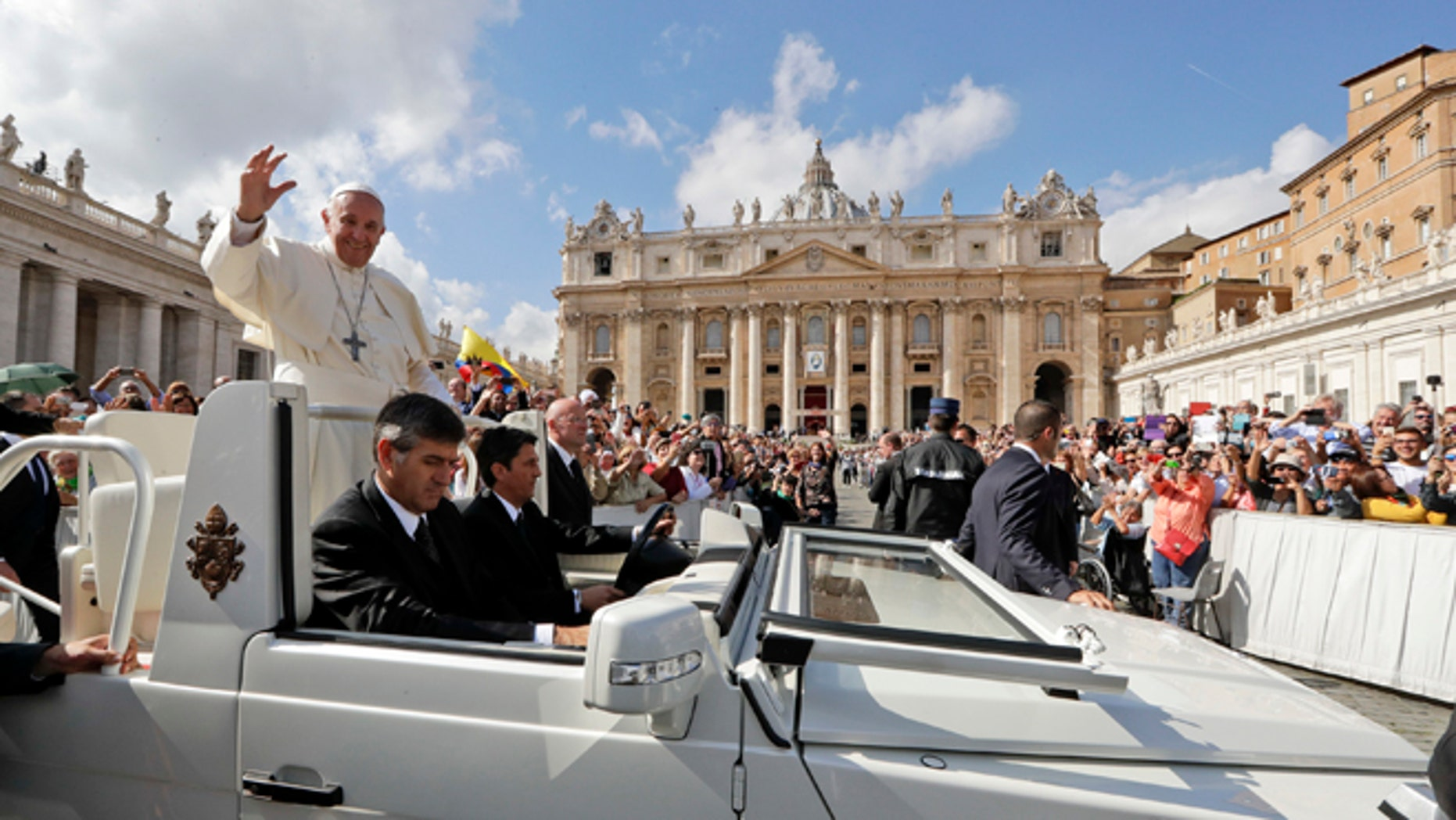 Pope Francis waves to faithful as leaves at the end of a jubilee mass he celebrated in St. Peter's Square, at the Vatican,  Sunday, Oct. 9, 2016. Pope Francis has named 17 new cardinals _ 13 of them under age 80 and thus eligible to vote in a conclave to elect his successor.  (AP Photo/Andrew Medichini)