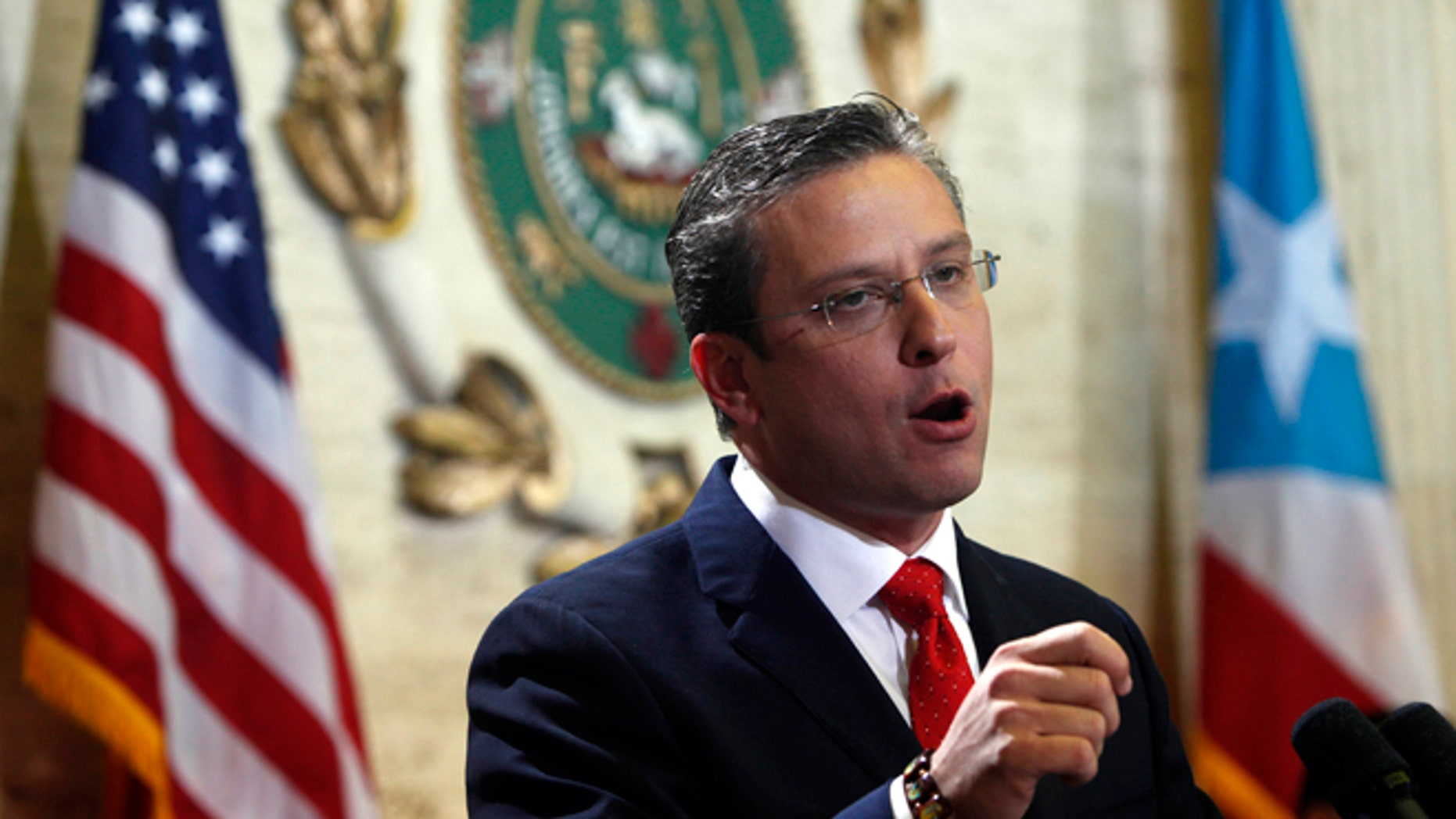 FILE - In this April 25, 2013 file photo, Puerto Rico Gov. Alejandro Garcia Padilla speaks during a state of the commonwealth address at the Capitol building in San Juan, Puerto Rico. A new plan backed by Garcia aims to boost revenue and tackle the U.S. territory's spiraling public debt by creating a 16 percent value-added tax, or VAT. If approved, manufacturers would pay the tax on raw materials and include it in the price of the product sold to retailers, who then would pass it on to consumers. (AP Photo/Ricardo Arduengo, File)