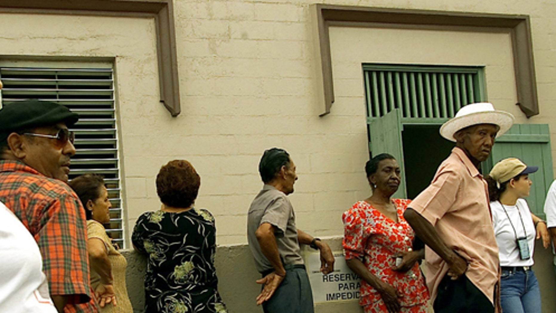 392573 03: (Puerto Rico Out) Vieques Residents Line Up At Polling Stations To Cast Their Vote In A Non- Binding Referendum Over The Future Of Navy Bombing Exercises July 29, 2001 On The Island Of Vieques. Puerto Rico. Option Two Calls For The Immediate And Permanent Termination Of Military Exercises Plus The Cleaning And Return Of Vieques Land To Its Citizens.  (Photo By Jose Jimenez/Primera Hora/Getty Images)