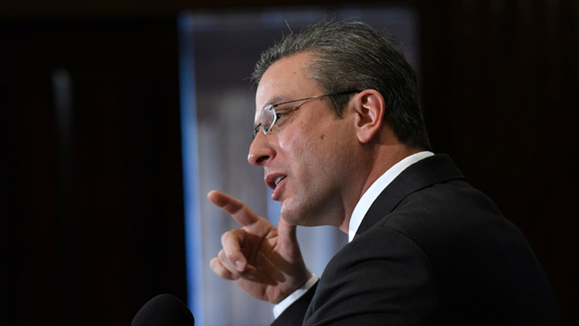 FILE - In this Dec. 16, 2015, file photo, Puerto Rico Gov. Alejandro Javier Garcia Padilla speaks at a luncheon at the National Press Club in Washington. Puerto Rico's governor unveiled a stark budget Monday, May 23, 2016, that sets aside more than $200 million for a critical bond payment as the U.S. territory sinks into a deep economic crisis.  (AP Photo/Sait Serkan Gurbuz,File)