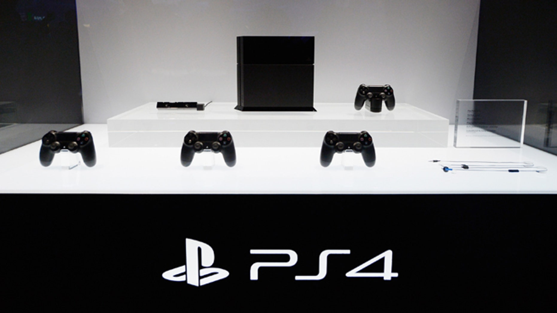 LOS ANGELES, CA - JUNE 11:  A Playstation 4 and its controllers on display at the Sony Playstation E3 2013 booth at the Los Angeles Convention Center on June 11, 2013 in Los Angeles, California. Thousands are expected to attend the annual three-day convention to see the latest games and announcements from the gaming industry.  (Photo by Kevork Djansezian/Getty Images)